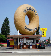 The landmark Randy Donuts is located in Inglewood, which is a city just southwest of downtown Los Angeles, Calif. Inglewood is also home to the fabulous Forum, which used to host the Los Angeles Lakers and the Los Angeles Kings hockey team, but since has been converted into a beautiful venue for concerts.